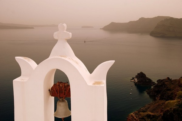 santorini tourism on the edge